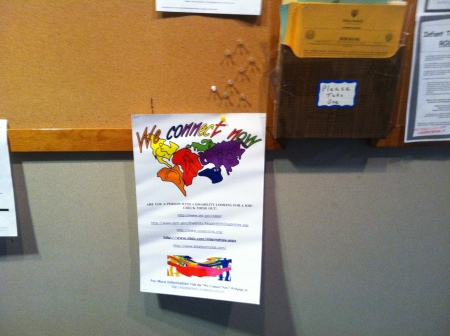 Photo of We Connect Now Disability Rights Campaign Poster displayed on a bulletin board at Holy Family University
