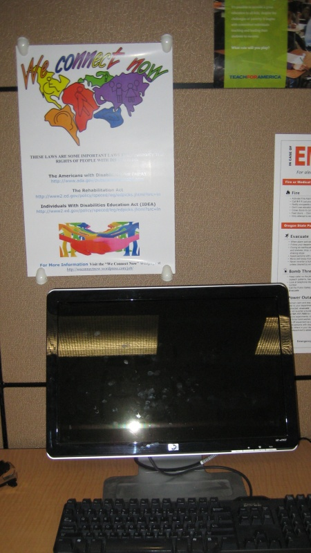 Photo of We Connect Now Disability Rights Campaign poster displayed near student workstation at Oregon State University's Office of Disability Access Services