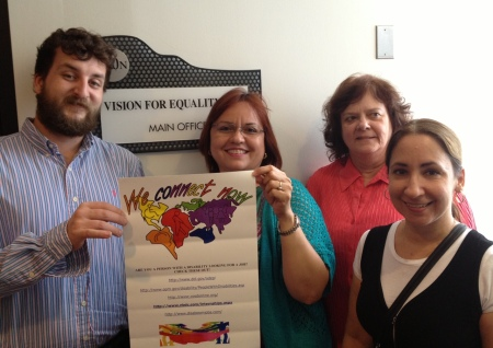 Photo of Abriendo Caminos Personnel Holding up a We Connect Now Disability Rights Campaign poster in Philadelphia, PA